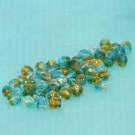 Glasschliffperlen blaugrün topas durchzogen