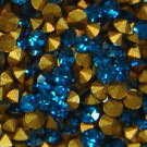 Strass-Steine capri blue gold-foiled